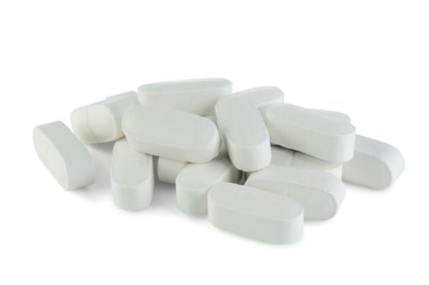 Högen of oblong calcium pills